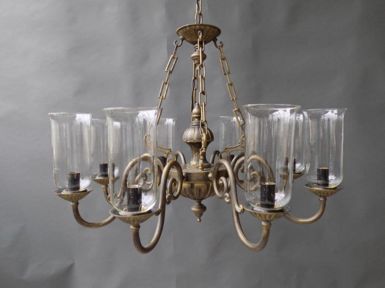 An 8 light solid brass chandelier