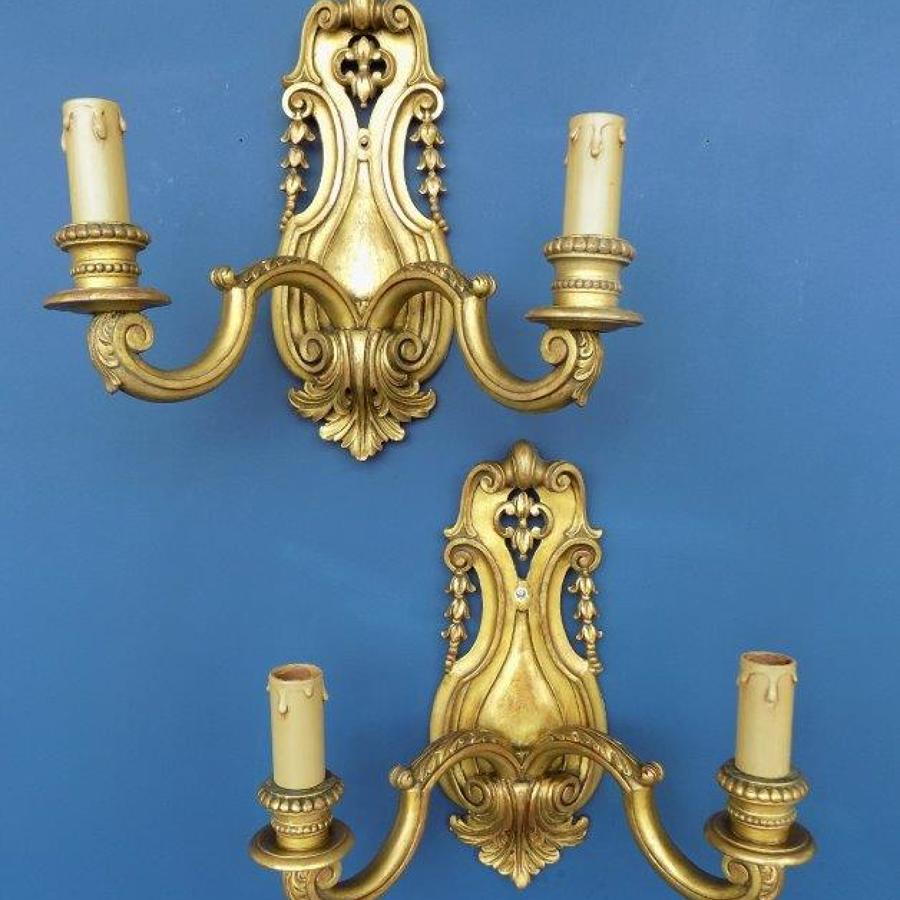 Pair of sconces, carved giltwood