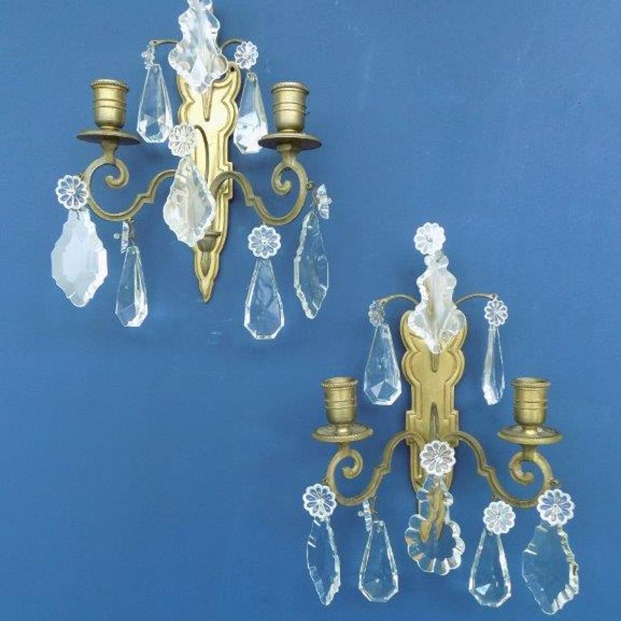 Brass framed wall sconces